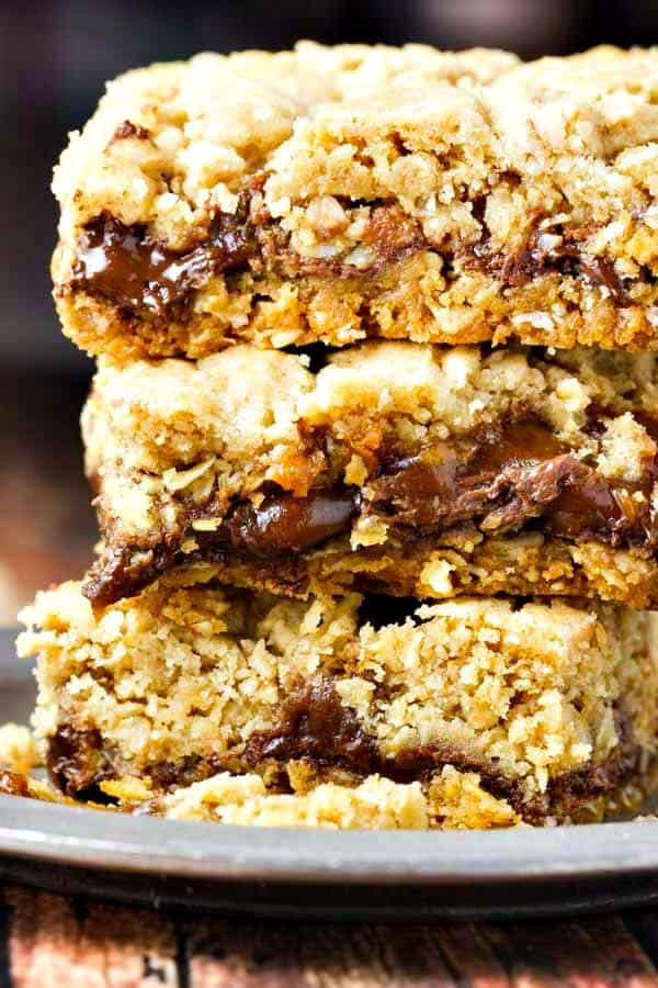 a closeup of a stack of three chocolate caramel bars