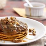 pumpkin pancakes with caramel syrup and pecans