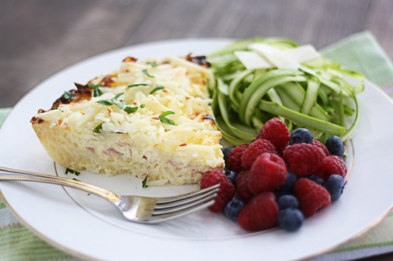 This easy quiche recipe has hash browns for both the crust and a crispy hash brown top! The ham, asparagus and swiss add wonderful flavor, it's a must try!