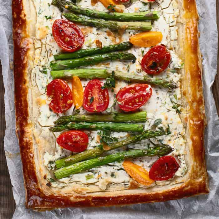 Puff pastry tart with asparagus and tomatoes.