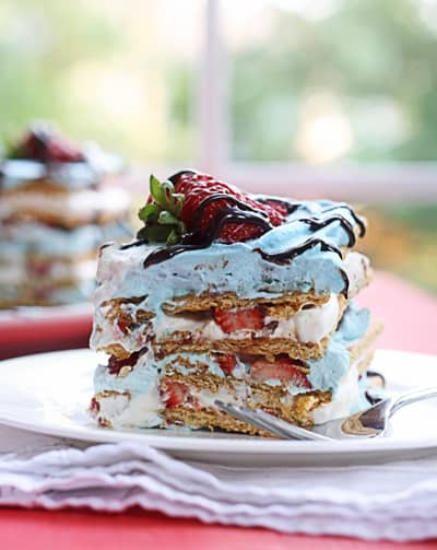 This Strawberry Icebox Cake with Graham Crackers is so easy and delicious you won't believe it. Color the whipped cream to serve at any holiday, too!
