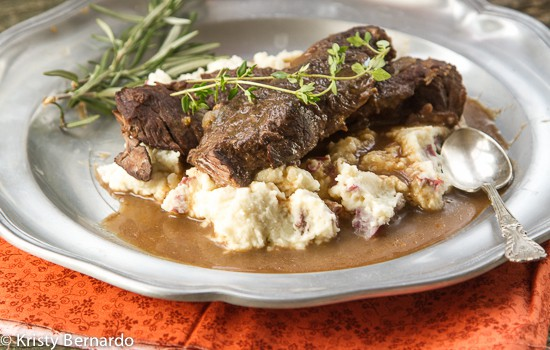 These Braised Beef Short Ribs are so tender you can eat them with a spoon. They literally fall apart and are filled with flavor!