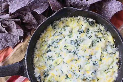 This recipe for Easy Spinach Artichoke Dip takes just a few minutes to throw together. A great appetizer that's hot and cheesy with a ton of flavor!