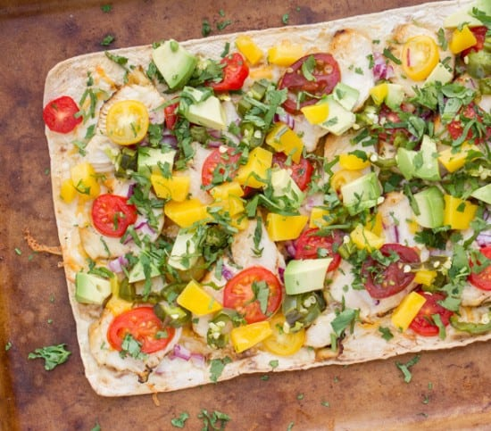 This flavorful chicken flatbread recipe has a smoky sauce, cilantro-lime chicken, mango & roasted jalapeno which makes for one killer flatbread pizza!