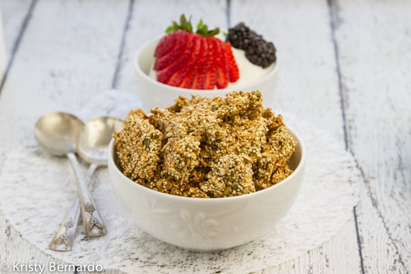 quinoa granola - a healthier and less sweet granola that's perfect to enjoy with fresh heart-healthy berries and creamy yogurt!