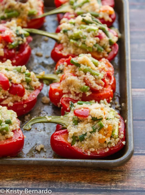 lemon quinoa stuffed peppers with asparagus, cherry tomatoes & a hidden goat cheese surprise! Good for you and really delicious!