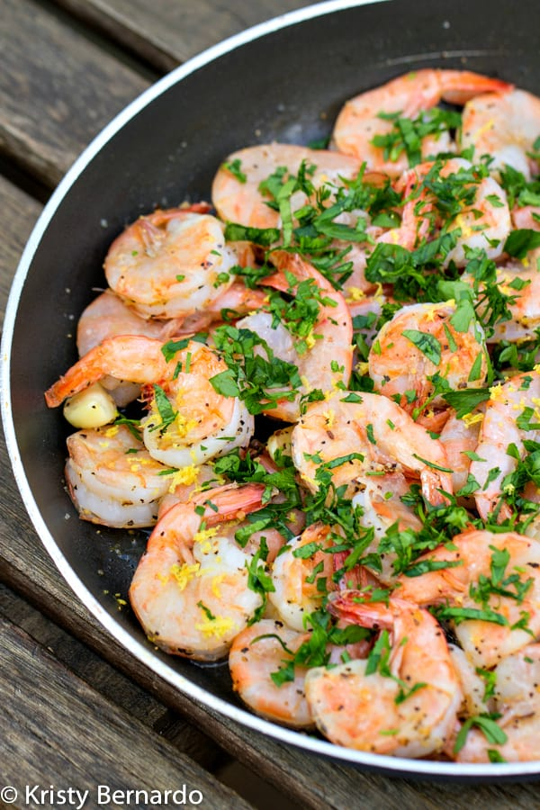 This easy recipe for Spicy Garlic Shrimp comes together in just 4 minutes. Fresh shrimp sauteed with garlic, crushed red pepper and lemon juice, delicious!