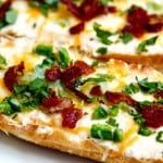jalapeno popper bread - creamy cream cheese, cheddar & jack, baked with fresh jalapeno then topped with bacon. Yes, it tastes as yummy as it sounds!