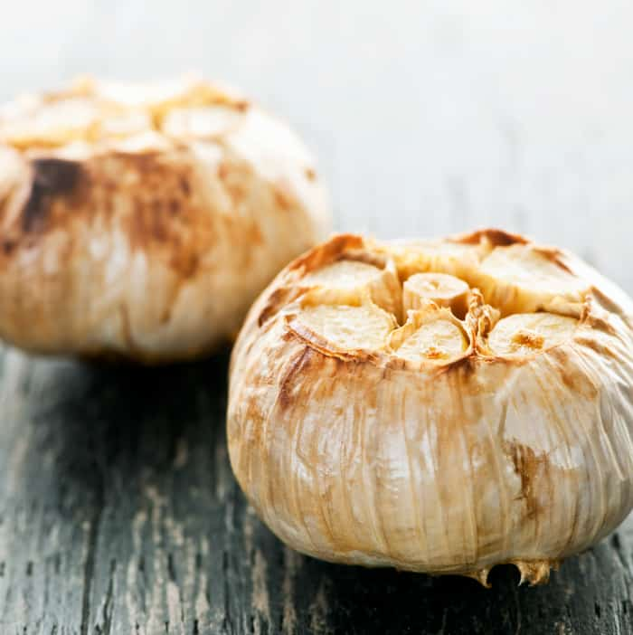 Close up of fresh roasted garlic bulbs