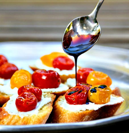 crostini with whipped goat cheese, slow-roasted tomatoes and a balsamic syrup