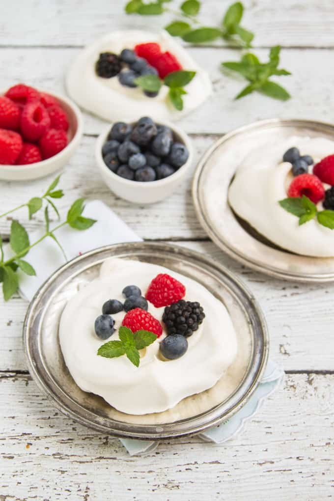 "meringues with fresh summer berries and vanilla creme fraiche - or ""what do make with leftover egg whites""! Such an easy, elegant dessert!"