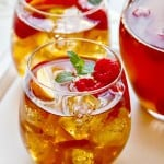 sweet tea sangria with raspberries and fresh summer peaches