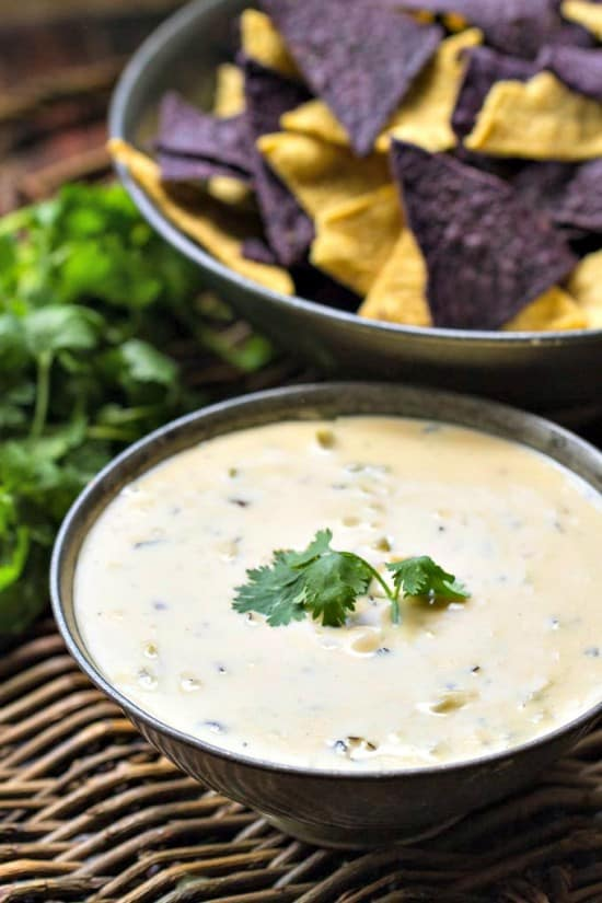 An easy, flavorful queso dip that's great alone or add green chiles for even more flavor - hatch, poblano or even canned!
