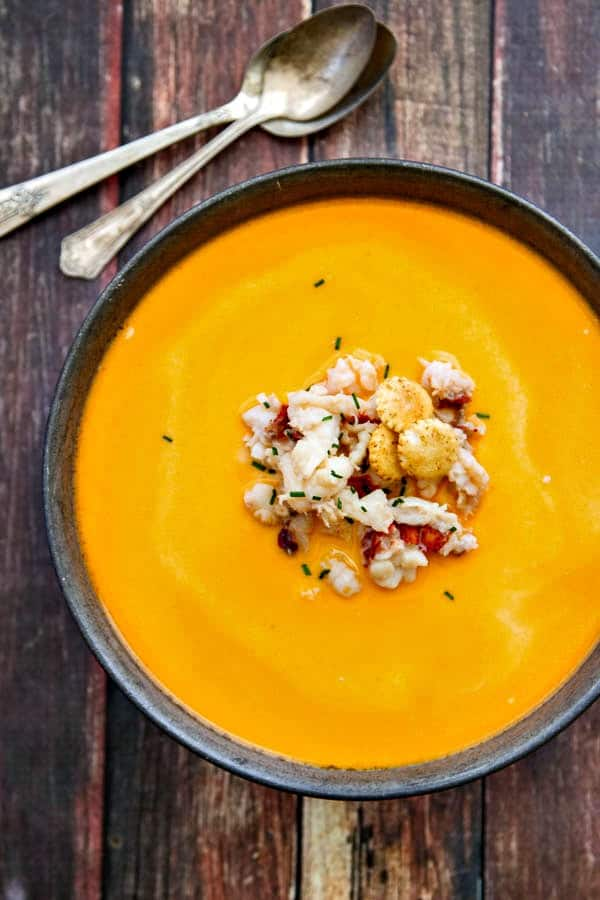 This creamy Lobster Bisque is made with loads of fresh lobster meat and is easier to make than you might think. Perfect for a special meal!