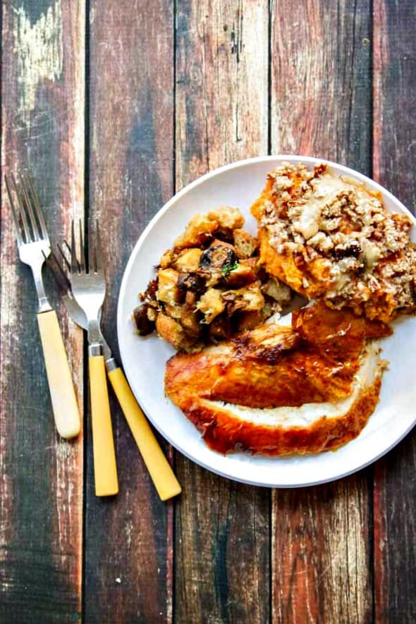 This juicy turkey recipe with crispy skin is easy! The secret is to start out low-and-slow then crank up the heat to crisp up the skin for the finish.