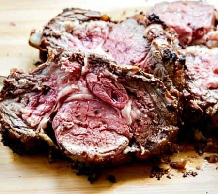 Standing Rib Roast (aka Prime Rib) couldn't be easier or be more popular on your holiday table! A superfast mustard, peppercorn and garlic wet rub seals in the juices and is out-of-this-world delicious!