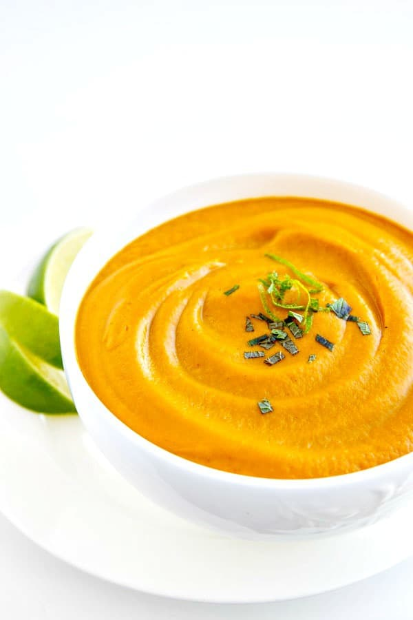 This ultra- creamy Roasted Carrot Soup is easy, delicious and healthy! Make it on the stove top or use your Vitamix; I've got directions for both!