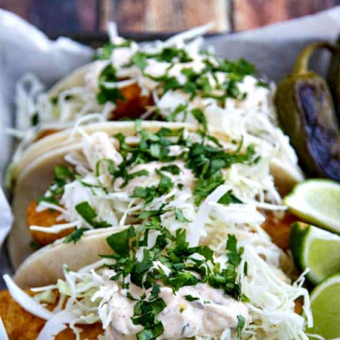 These Beer Battered Fish Tacos light and crispy with a killer sauce that brings all the flavors together!