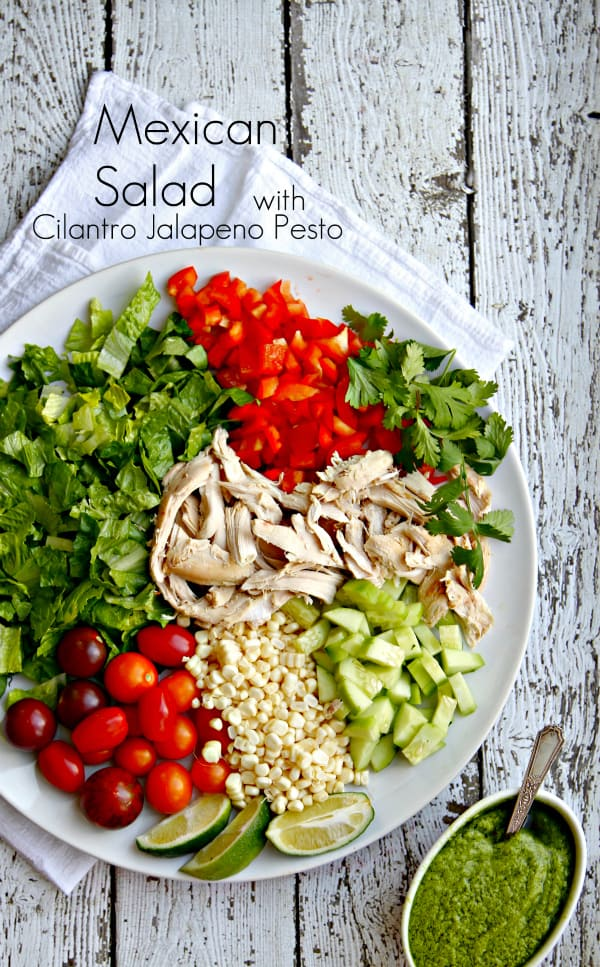 This Mexican Salad with Cilantro Jalapeño Pesto is healthy and you won't believe the amazing flavor of the pesto! Freeze the pesto, pick up a rotisserie chicken and thaw your pesto while you're chopping a few veggies. Voilà! Dinner is done in no time!