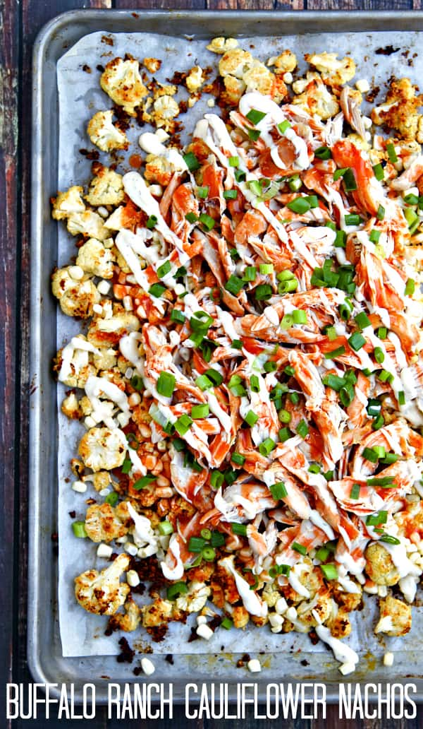 "Buffalo Ranch Roasted Cauliflower ""Nachos"" - Roasted cauliflower with ranch dressing, fresh corn, shredded chicken and a hearty drizzle of buffalo sauce and a little more ranch. Get your veggies the delicious way! You can also make the Ranch Roasted Cauliflower on its own - so good!"