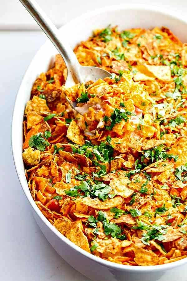 Dorito Casserole!! Don't knock it until you try it...plus it's great for picky kids (there's an entire rotisserie chicken in the filling)!