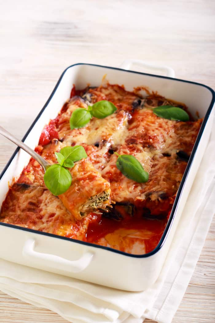 Eggplant rollatini in a white baking dish