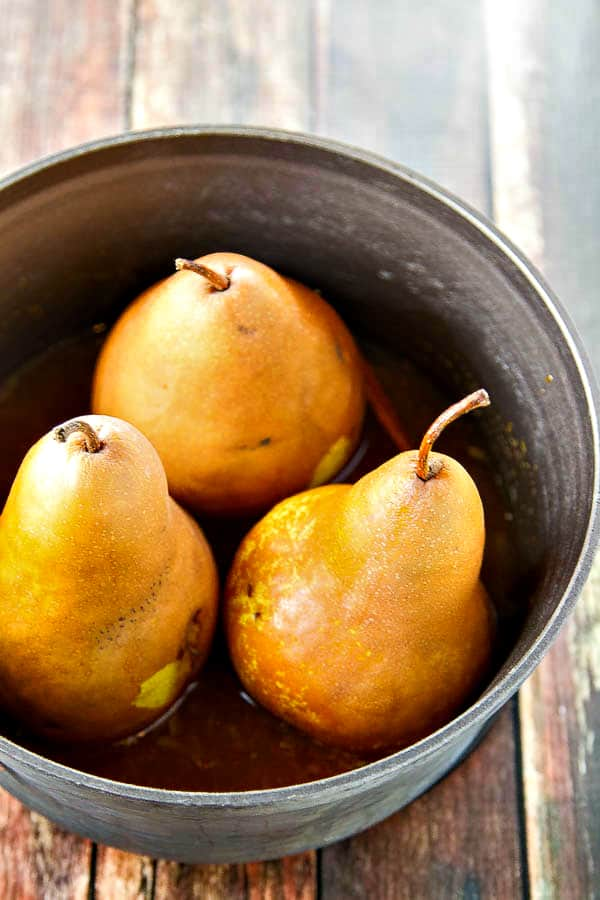 whole pears in a metal pot ready to be cooked and made into healthy poached pears