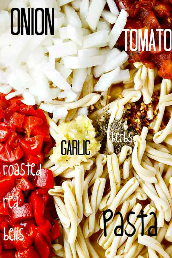 One Pot Pasta with Roasted Red Peppers, and a creamy Goat Cheese sauce! Just toss your ingredients into the pot with your UNCOOKED pasta and go!