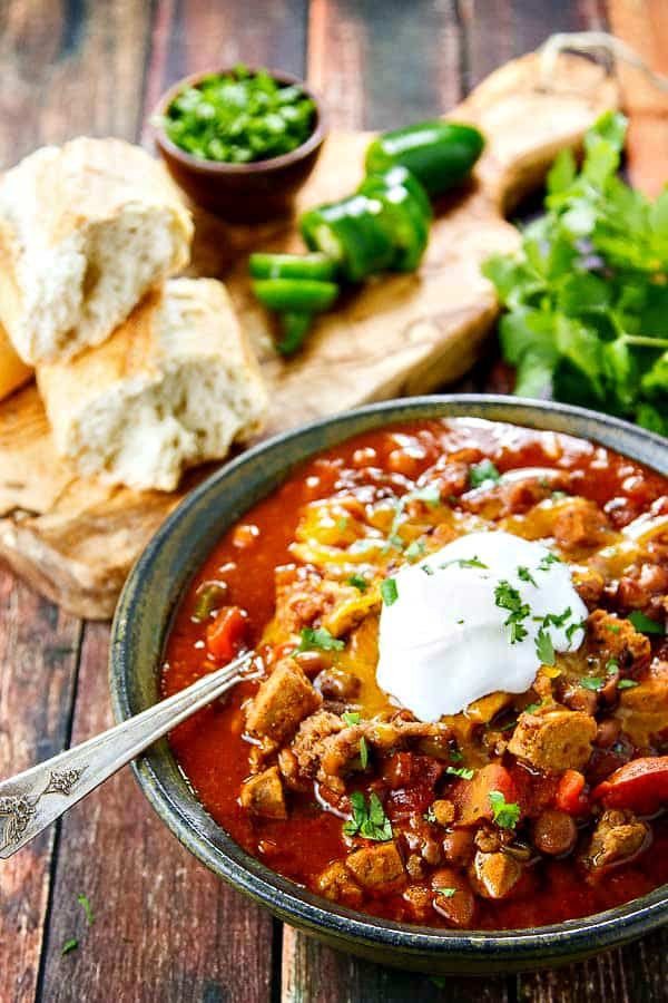 Boilermaker Chili is a fabulous tailgating chili or for your football party! This version is healthier and uses lots of flavorful chicken sausage to keep everyone happy.