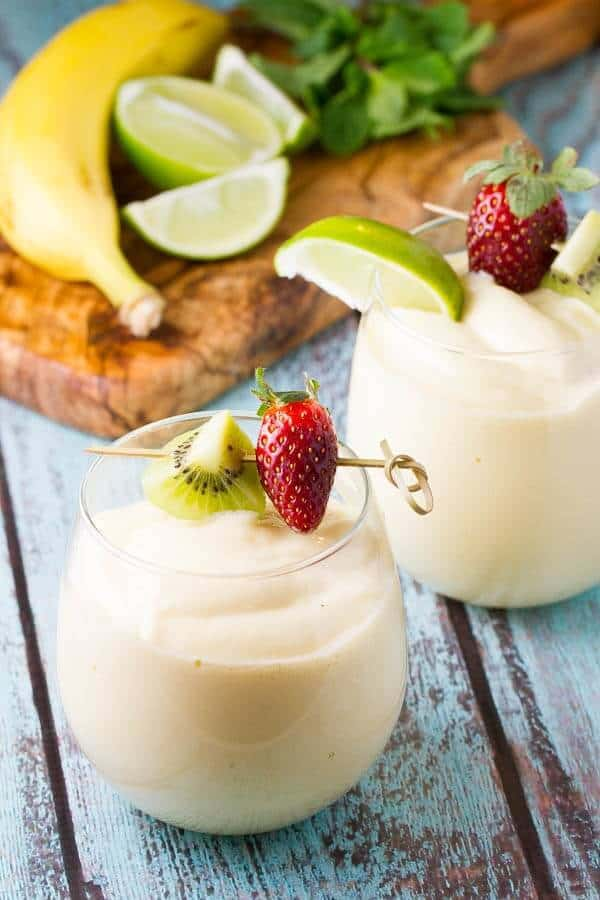 A Tropical Smoothie recipe with mango, banana and pineapple PLUS a surprising ingredient that adds protein and will make your smoothies SUPER creamy!