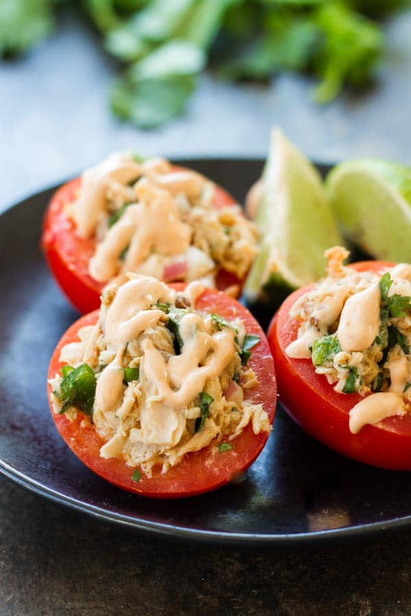 Mexican Tuna Salad Stuffed Avocados - just a few ingredients, super healthy and it tastes sooo good! You can also use tomatoes (or both)!