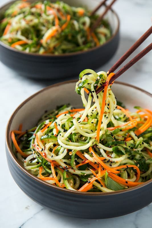 """Asian Sesame Cucumber Salad - We've answered the question """"What to do with cucumbers?"""" The ULTIMATE list including appetizers, soups, salads, sides and more!"""