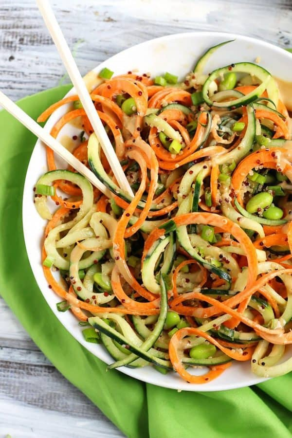 "Spiralized Asian Quinoa Salad with Peanut Dressing - We've answered the question ""What to do with cucumbers?"" The ULTIMATE list including appetizers, soups, salads, sides and more!"