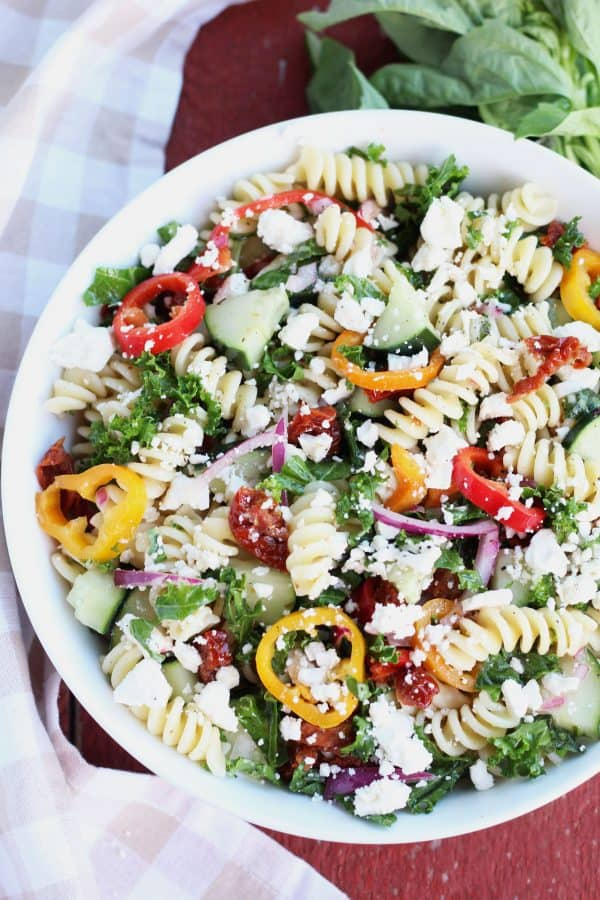 """Sun-Dried Tomato and Kale Pasta Salad - We've answered the question """"What to do with cucumbers?"""" The ULTIMATE list including appetizers, soups, salads, sides and more!"""