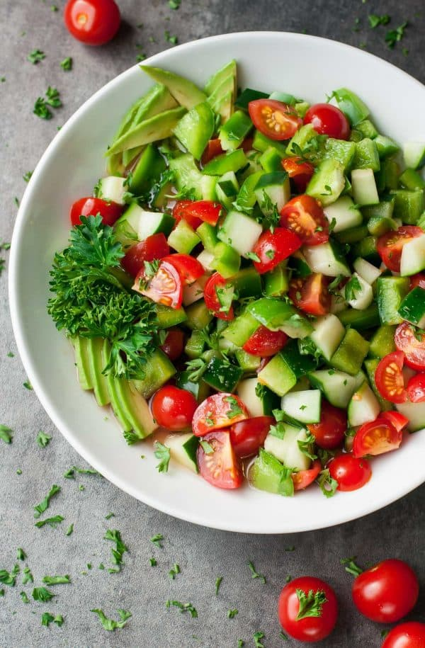 """Tomato Cucumber Avocado Salad - We've answered the question """"What to do with cucumbers?"""" The ULTIMATE list including appetizers, soups, salads, sides and more!"""