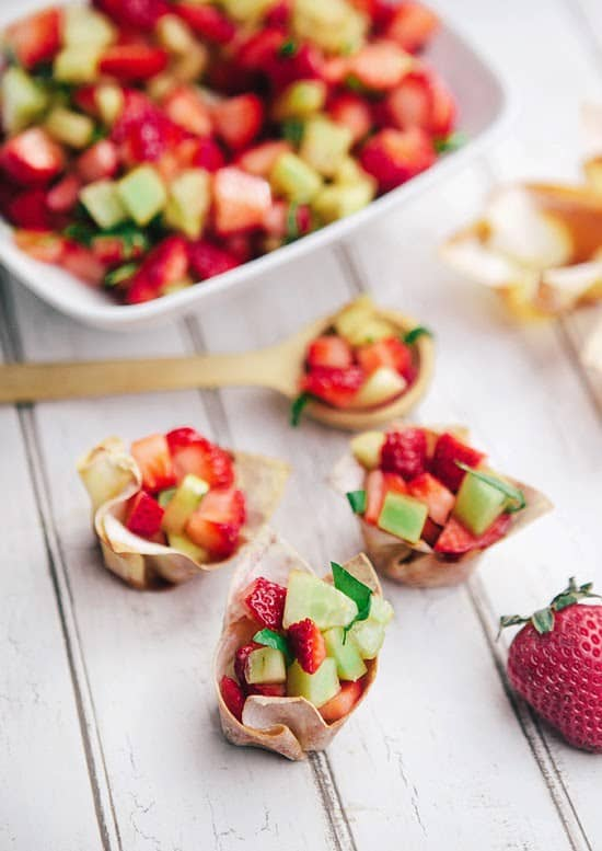 """Strawberry Cucumber Salad Cups - We've answered the question """"What to do with cucumbers?"""" The ULTIMATE list including appetizers, soups, salads, sides and more!"""