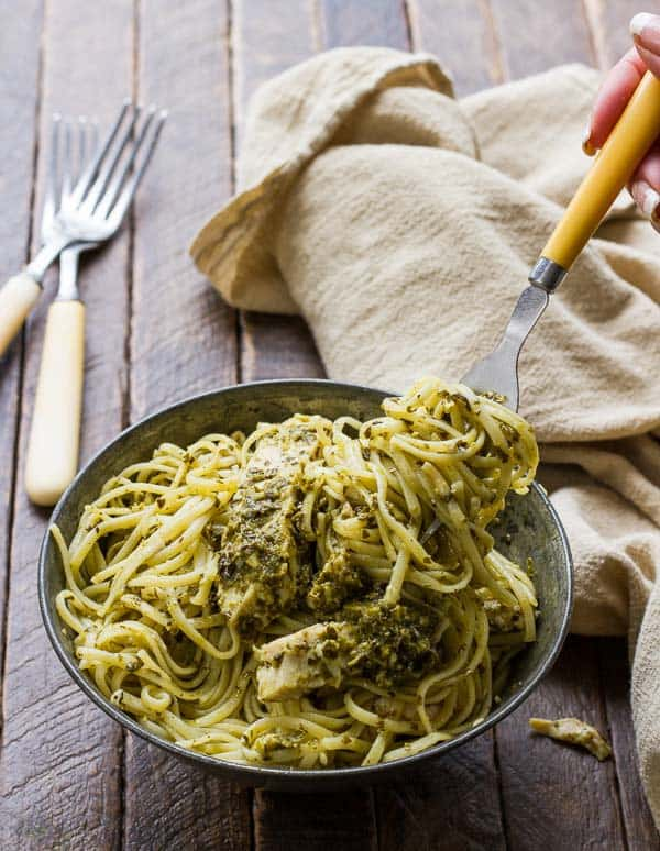 This Pesto Pasta with Chicken and Parmesan has just FOUR ingredients and ONE pan! It is so quick, easy and delicious that now I make sure to always have the ingredients on hand!