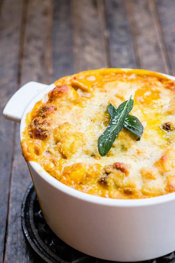 This Creamy Baked Pumpkin Gnocchi with Italian Sausage is so good you will be dancing in your kitchen!! Sophisticated yet easy to make and something the whole family will love!