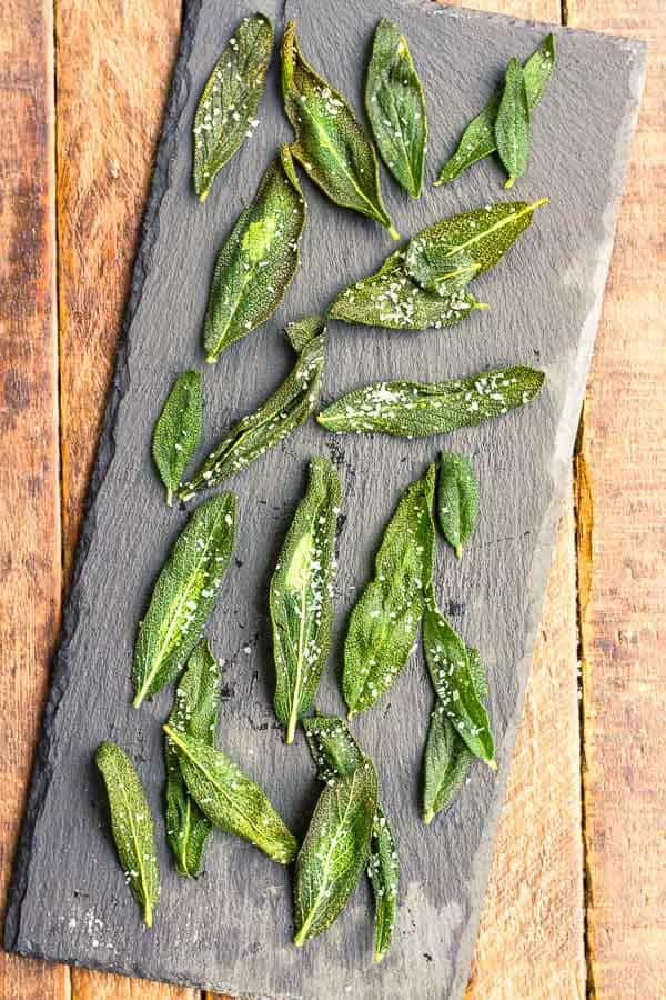 Fried Sage Leaves are so simple and an addictive, delicious snack! Use them to top your fall dishes for a sophisticated finish, too!