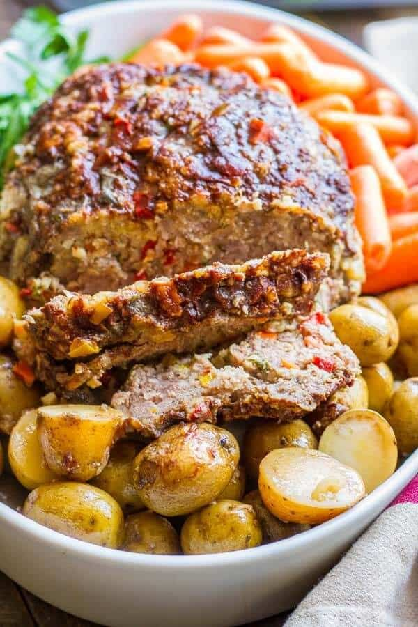 Delicious meatloaf with loads of veggies, shaved parmesan and a wonderful balsamic glaze! Crockpot meatloaf is so simple!