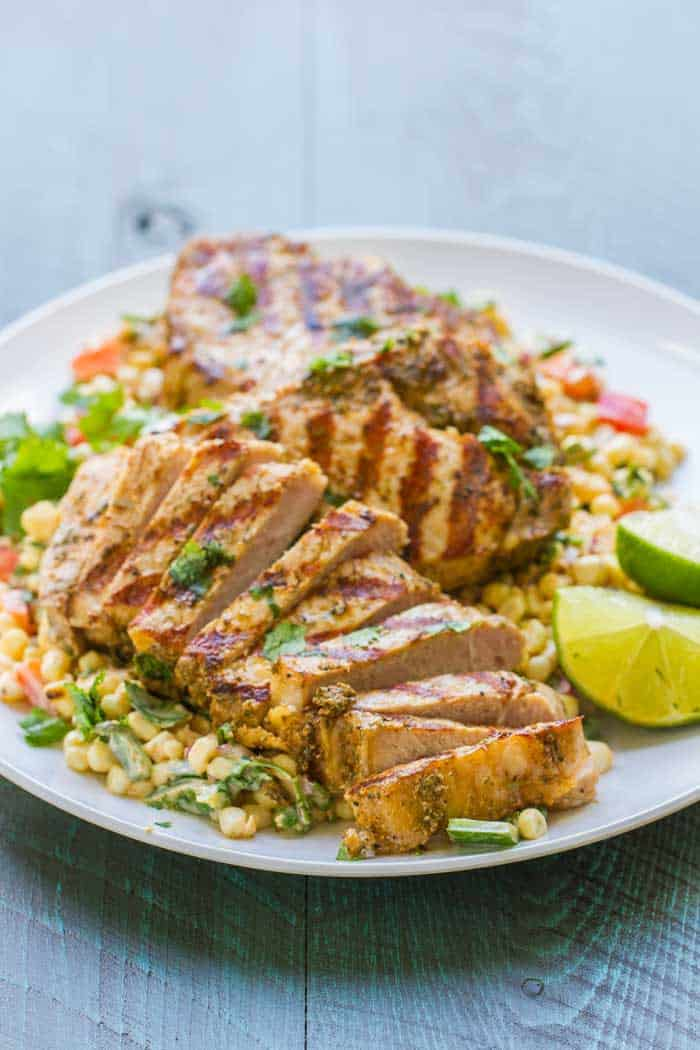 Grilled Boneless Pork Chops with Mexican Corn Salad. Healthy and SO flavorful! The easiest, most flavorful salad (I swear I could drink the dressing)!