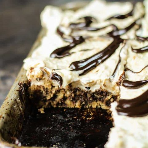 Chocolate Chip Cookie Peanut Butter Slab Pie served in the pan with one piece missing.