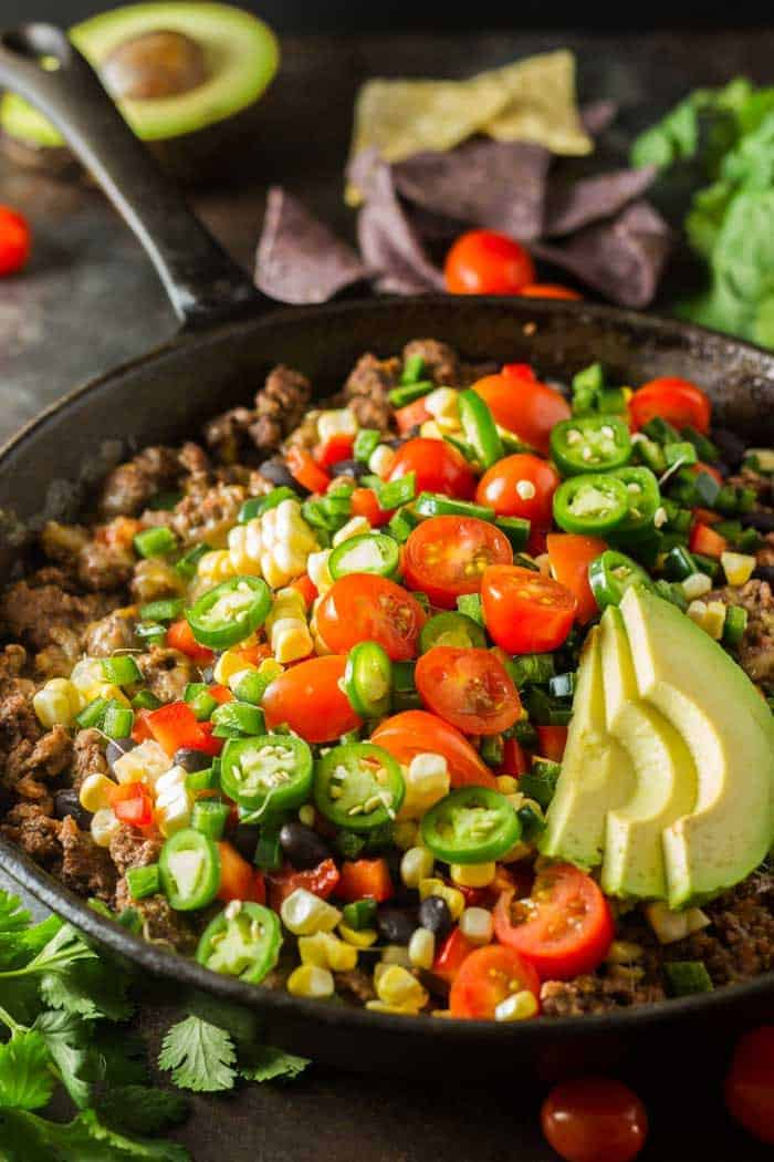 Healthy nachos in a cast iron skillet.