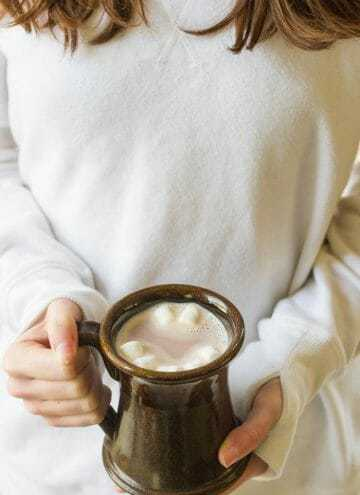 Girl holding mug of hot chocolate with marshmallows (TruMoo Chocolate Milk)