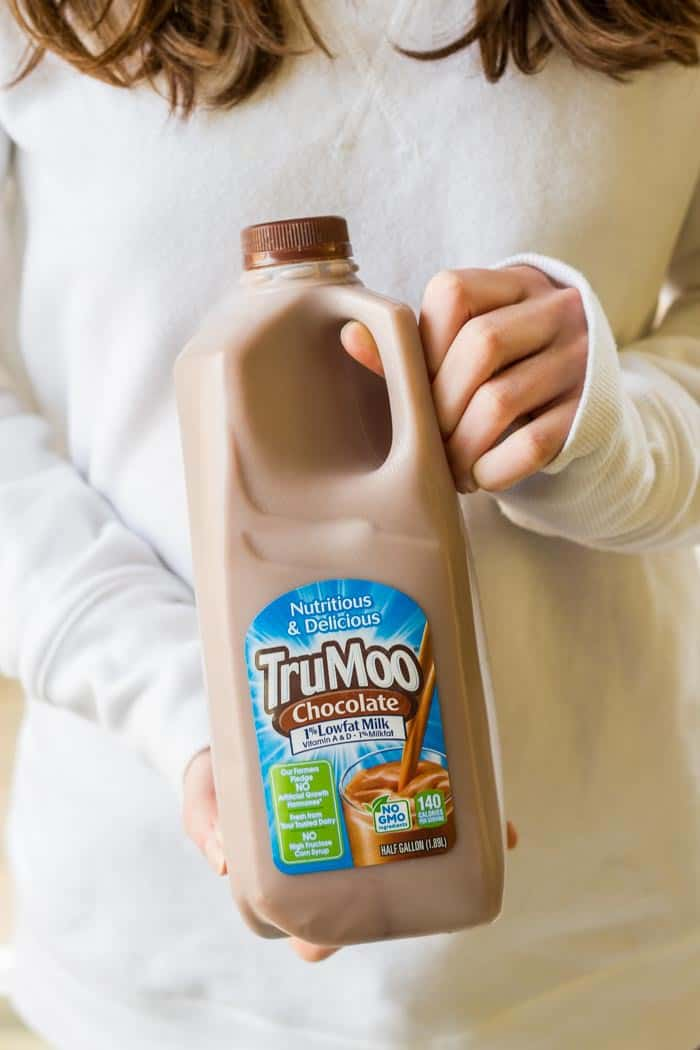 Girl holding carton of TruMoo chocolate milk