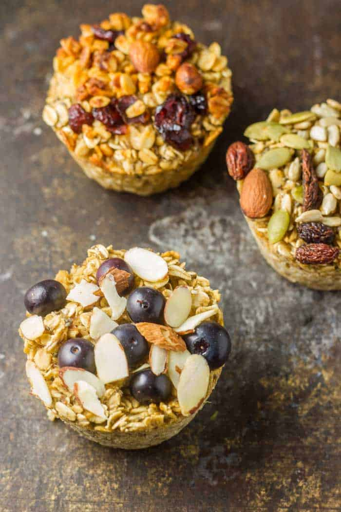 Baked Oatmeal Cups in muffin tin just out of the oven on a black plate.