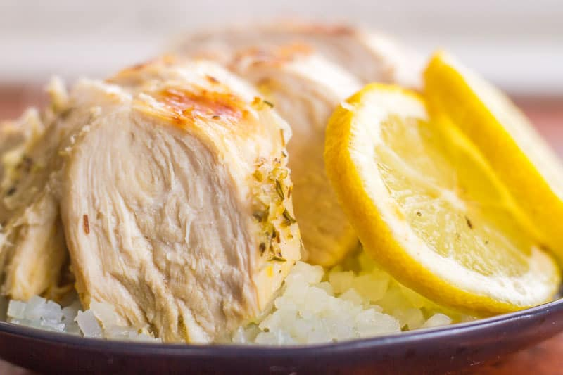 Citrus Grilled Chicken on a plate over cauliflower rice