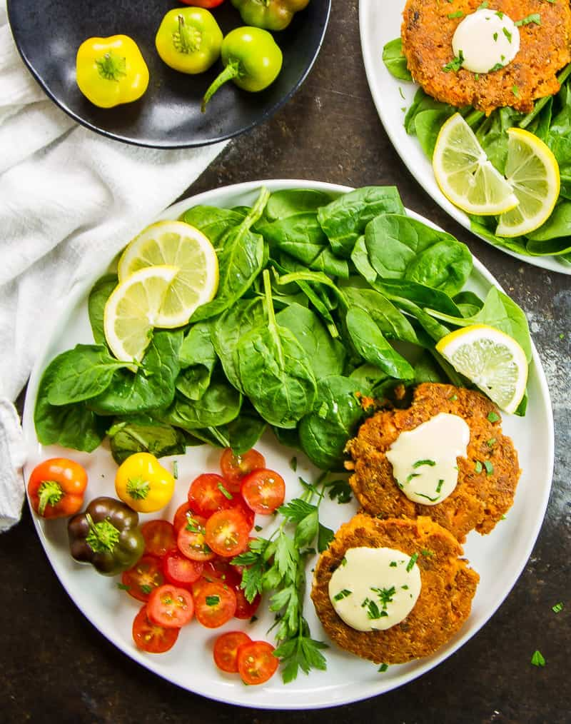 Low Carb Southern Salmon Patties with Sriracha Aioli on a white plate next to a white napkin on a dark table. | Low Carb Salmon Patties