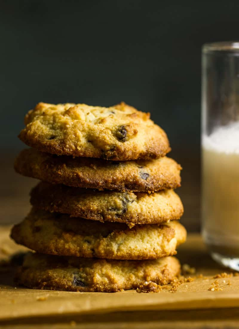 A stack of keto chocolate chip cookies next to a glass of milk   Low carb chocolate chip cookies