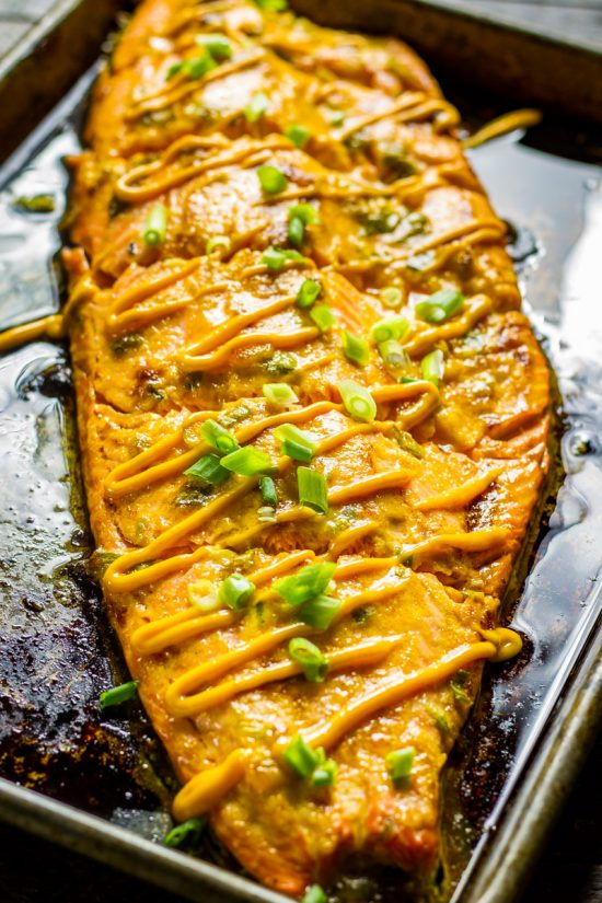 Baked Salmon with Sriracha Mayo just out of the oven on a sheet pan.
